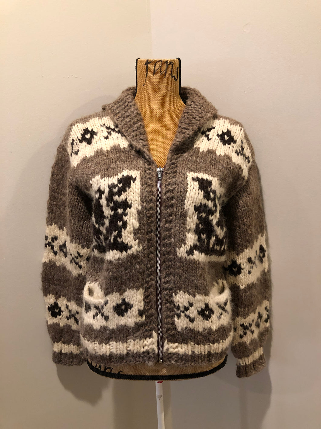 Cowichan style hand spun and hand knit wool zip cardigan in taupe brown, beige, white and dark brown with thunderbird design, shawl collar, zipper and pockets.
