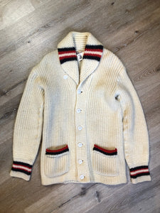 Kingspier Vintage - Curl-Rite by Rice-Knit Sportswear 1950's curing sweater in cream with red and black strip details, shawl collar, button closures and pockets. 100% wool. Size medium. Made in Nova Scotia.