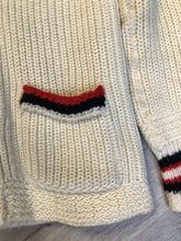 Load image into Gallery viewer, Kingspier Vintage - Curl-Rite by Rice-Knit Sportswear 1950's curing sweater in cream with red and black strip details, shawl collar, button closures and pockets. 100% wool. Size medium. Made in Nova Scotia.