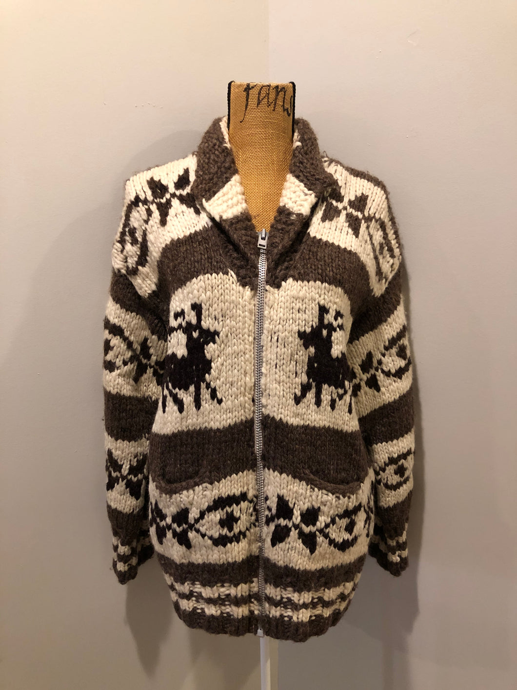 Genuine Cowichan hand spun, hand knit wool cardigan in cream, taupe brown and black with deer design, zipper and pockets.