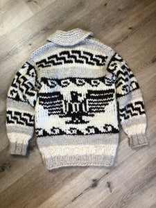 Cowichan style hand knit wool pullover sweater in cream, grey and dark brown with thunder bird design and shall collar.