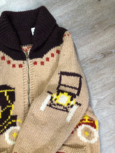 Load image into Gallery viewer, Mary Maxim hand knit wool zip cardigan in light brown with dark brown, red, yellow and cream with antique car design, raglan sleeves, zipper and pockets. Made in Nova Scotia.