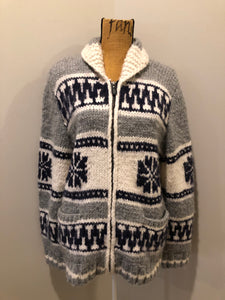 Cowichan style hand knit wool zip cardigan in white, grey and navy with floral design, zipper and pockets.