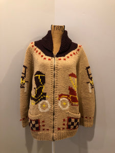 Mary Maxim hand knit wool zip cardigan in light brown with dark brown, red, yellow and cream with antique car design, raglan sleeves, zipper and pockets. Made in Nova Scotia.