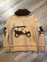 Load image into Gallery viewer, Mary Maxim hand knit zip cardigan in beige with dark brown, green and yellow antique car design. Made in Nova Scotia.