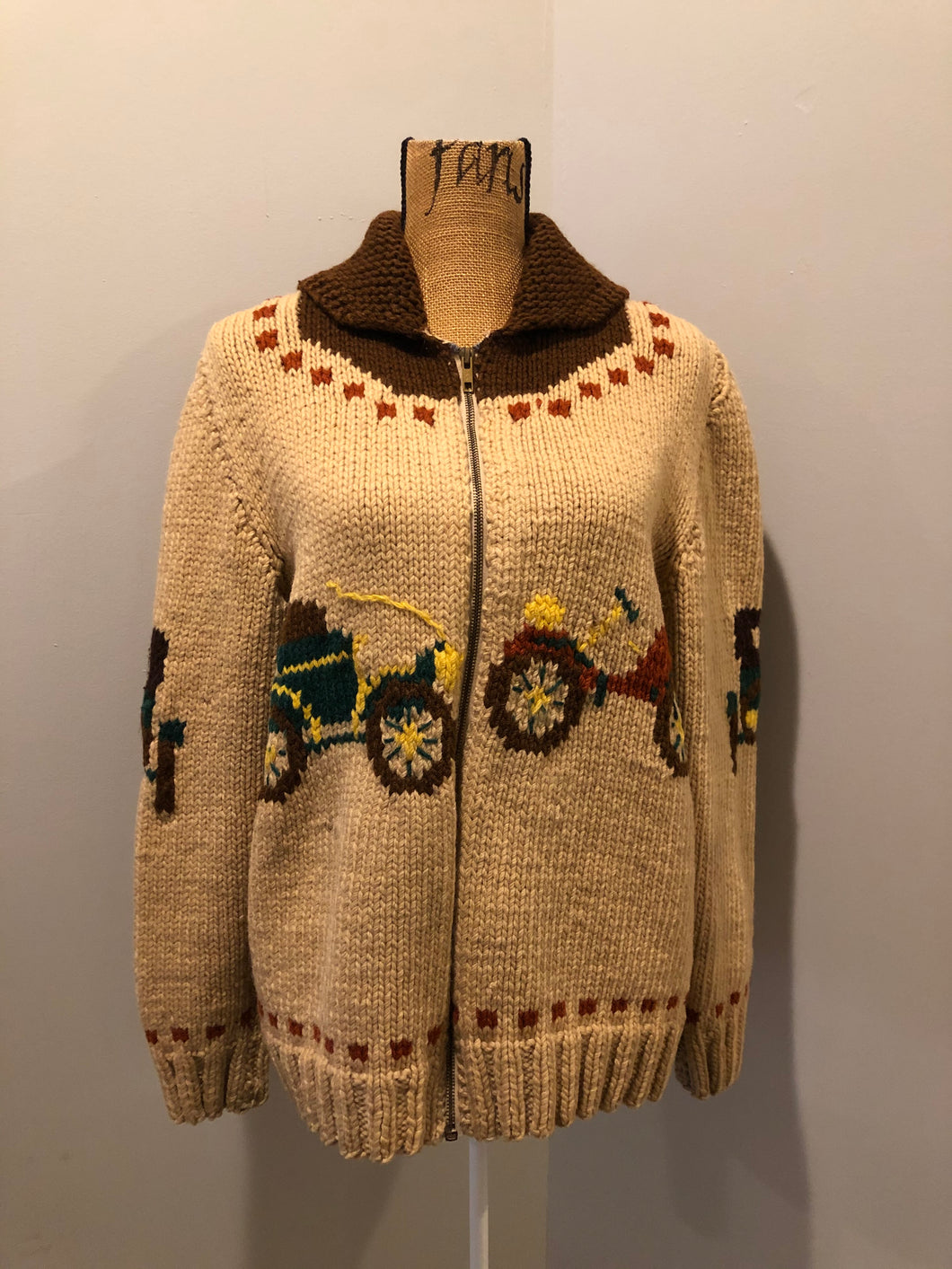 Mary Maxim hand knit zip cardigan in beige with dark brown, green and yellow antique car design. Made in Nova Scotia.