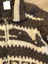 Load image into Gallery viewer, Cowichan style hand spun, hand knit zip cardigan in taupe brown and cream with whale pattern. Size medium.