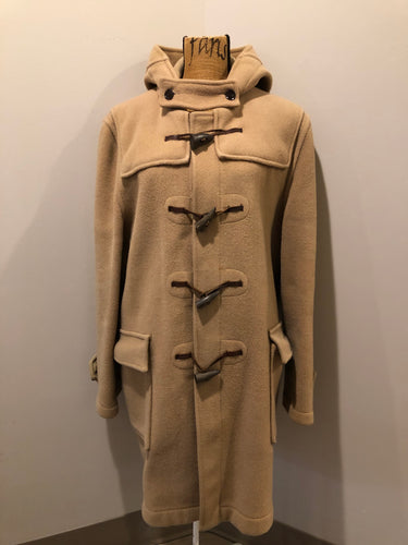 Gloverall tan wool duffle coat with hood, zipper, wooden toggles and flap pockets. Made in England. Size 42.