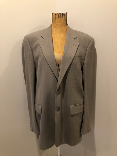 Kingspier Vintage - WM.H. Leishman (sold at Tip Top Tailors) two piece medium grey 100% pure virgin wool suit.The jacket is a single breasted, two button notch lapel with two flap pockets and two inside pockets. Pants are pleated with welt pockets. Made in Canada.