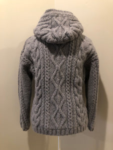 Laundromat 100% wool cardigan in grey with hood, zipper, vertical pockets and one inside pocket. Fully lined in soft fleece. Made in Nepal.