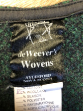 Load image into Gallery viewer, Deweevers wovens 100% wool cardigan in deep green with red design woven in, patch pockets and silver buttons with floral design. Made in Aylesford, NS. Size medium.