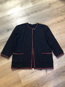 Black felted wool cardigan with one button closure at the top, patch pockets and tiny flower embroidered trim.