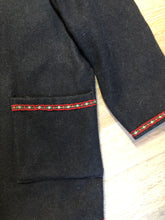 Load image into Gallery viewer, Black felted wool cardigan with one button closure at the top, patch pockets and tiny flower embroidered trim.