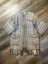Load image into Gallery viewer, Daurene Lewis 100% wool hand spun, hand woven and hand made cardigan. The cardigan features two lined patch pockets. two wooden button closures at the top and a wool fringe at the bottom. Made in Annapolis Royal, Nova Scotia.