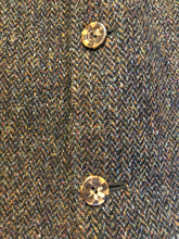 Load image into Gallery viewer, Harris Tweed brown and blue herringbone 100% wool jacket. This jacket is a three button, notch lapel with two flap pockets, a breast pocket and three inside pockets. Made in the Czech Republic.