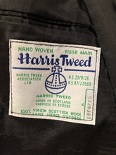 Load image into Gallery viewer, Harris Tweed black and white 100% wool tweed jacket. This jacket is a two button, notch lapel with two flap pockets, a breast pocket and two inside pockets. Made in Canada. Size 40.