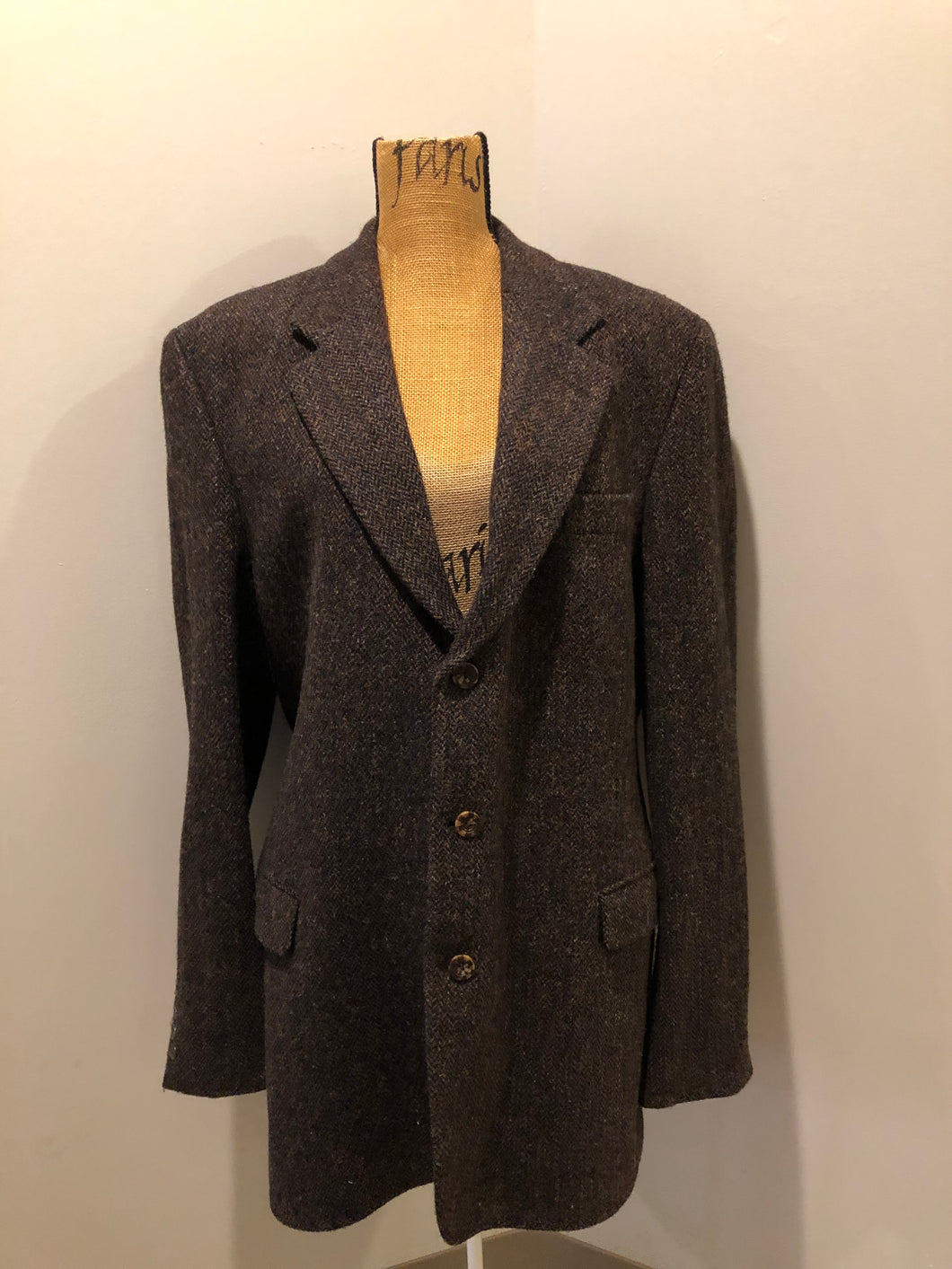 Harris Tweed brown and blue herringbone 100% wool jacket. This jacket is a three button, notch lapel with two flap pockets, a breast pocket and three inside pockets. Made in the Czech Republic.
