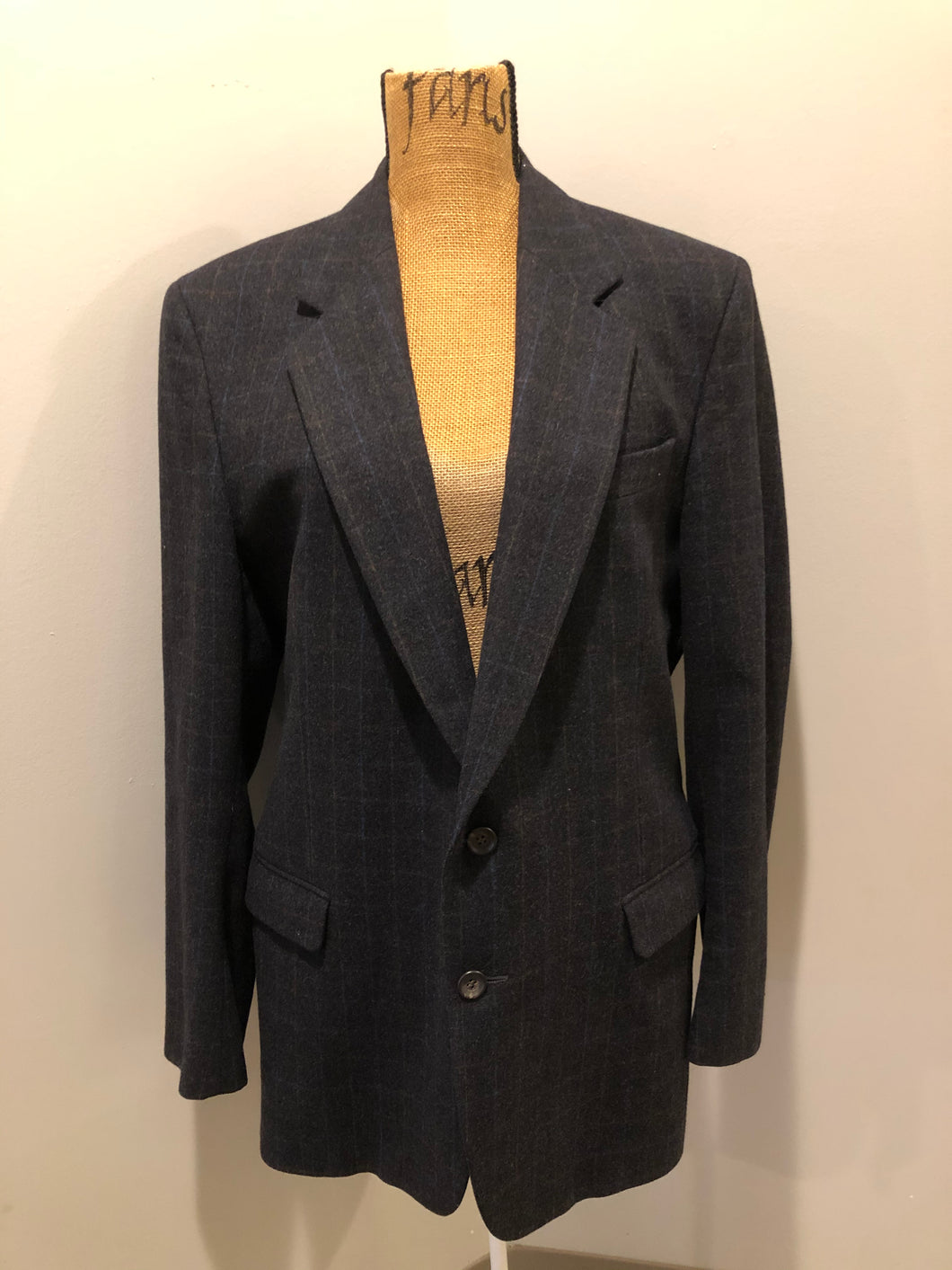 Chaps by Ralph Lauren slate grey with blue and red subtle stripe 100% wool jacket. This jacket is a two button, notch lapel with two flap pockets, a breast pocket and three inside pockets. Made in Canada.
