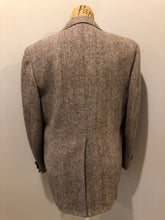 Load image into Gallery viewer, Harris Tweed beige with rust and grey flecks 100% wool tweed jacket. This jacket is a two button, notch lapel with two flap pockets, a breast pocket and two inside pockets. Made in Canada. Size 42R.
