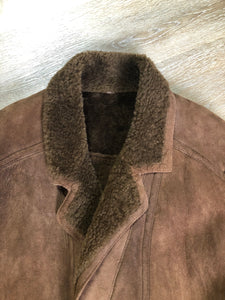 Kingspier Vintage - Hide Society medium brown shearling coat This coat features shearling lining, button closures, pockets and one inside zip pocket. Made in Canada. Size 10.