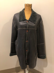 Reilly Olmes espresso brown coat with grey/ green shearling trim and lining, button closures and vertical pockets. Made in Argentina. Size large.