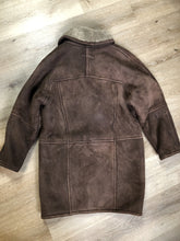 Load image into Gallery viewer, Kingspier Vintage - Positano Pelle dark brown shearling coat. This coat features shearling trim and lining, shall collar, wooden button closures and patch pockets. Made in Turkey. Size small.