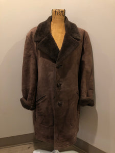 Kingspier Vintage - Bovet medium brown shearling coat. This coat features shearling trim and lining, wooden button closures and patch pockets.