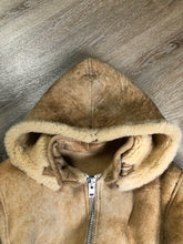 Load image into Gallery viewer, Kingspier Vintage - Ewe Wear, genuine sheepskin hooded bomber style jacket. This jacket features shearling lining, hood, zipper closure and slash pockets. Made in Kingston, Nova Scotia. Size XS.