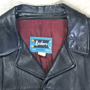 Roxboro Casuals black leather jacket with button closures, zipper, two flap pockets and a red lining.