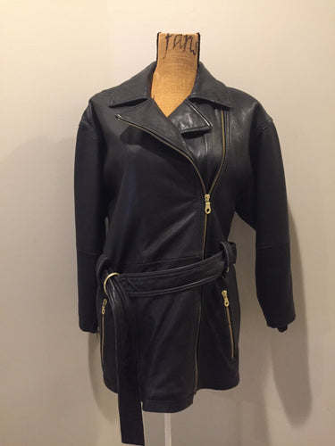 Kingspier Vintage - March New York black lambskin leather jacket with gold zipper, zip slash pockets, belt and storm flap in the back. Leather is buttery soft. Size XS.