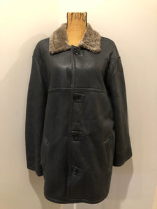 Keep Basic dark brown smooth leather shearling coat with button closures and three patch pockets. Made in Italy.