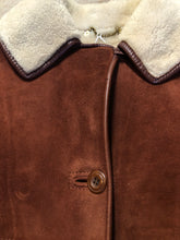 Load image into Gallery viewer, Antartex rust coloured suede sheepskin coat with shearling trim and lining, button closures and patch pockets. Made in Scotland. Size 10.