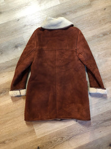 Antartex rust coloured suede sheepskin coat with shearling trim and lining, button closures and patch pockets. Made in Scotland. Size 10.
