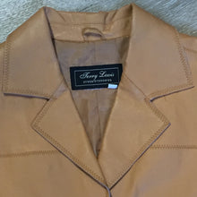 Load image into Gallery viewer, Jerry Lewis tan leather jacket with button closures and patch pockets. Size medium.