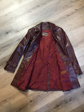"Load image into Gallery viewer, Etienne Aguier burgundy leather jacket with button closures, patch pockets, belt and ""A"" decorative details. Size small."