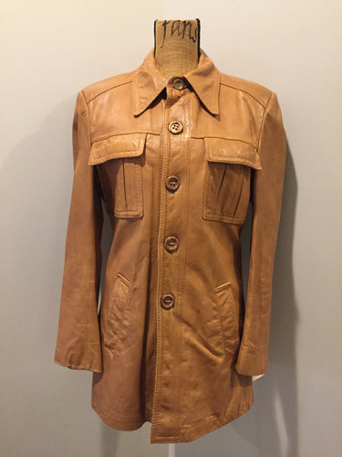 Kingspier Vintage - Roger de Blois inc brown leather jacket with button closures, two slash pockets, two flap pockets on the chest and a quilted lining. Made in Quebec.