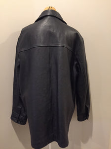 Gap black leather jacket with button closures, slash pockets, inside pocket and quilted lining. Size large.