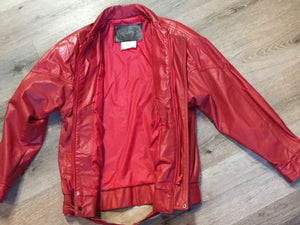 Kingspier Vintage - Zaggara Designs red leather jacket with hidden zipper, slash pockets, inside pocket and a belt at the waist. Size small.