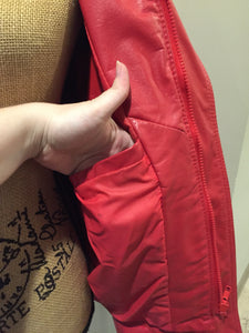 Zaggara Designs red leather jacket with hidden zipper, slash pockets, inside pocket and a belt at the waist. Size small.