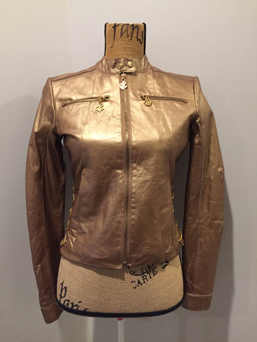 "Kingspier Vintage - Rocawear metallic gold leather moto jacket with ""RW"" detail zippers, chain lace-up detail on sides and ""ROCAWEAR"" written in chain across the back. There is a front zipper, two horizontal zip pockets on the chest, two snap closures on the stand up collar and a pocket on the inside. Size small."