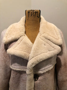 "Dave Epstein ""Rice Sportswear"" beige suede coat with shearling trim and lining, button closures and patch pockets. Made in Canada."