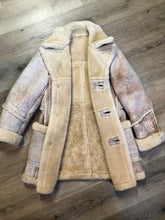 "Load image into Gallery viewer, Dave Epstein ""Rice Sportswear"" beige suede coat with shearling trim and lining, button closures and patch pockets. Made in Canada."