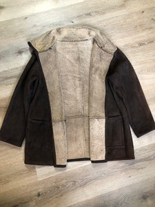 Doncaster shearling coat with shearling lining, button closures and patch pockets. Size medium.
