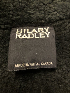 Hilary Riley Army Green suede coat with shearling trim and lining, button closures and patch pockets. Made in Canada.