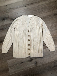 Kingspier Vintage - Vintage hand knit cardigan in cream with button closures. Made in Canada. Size Medium.