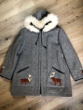 Load image into Gallery viewer, Kingspier Vintage - James Bay pure virgin wool northern parka in grey. This parka features a hood with white fur trim, zipper closure, quilted lining, knit inside hidden cuffs, patch pockets, felt deer appliqués on the front and on the sleeves. Made in Canada.