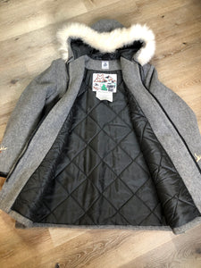 Kingspier Vintage - James Bay pure virgin wool northern parka in grey. This parka features a hood with white fur trim, zipper closure, quilted lining, knit inside hidden cuffs, patch pockets, felt deer appliqués on the front and on the sleeves. Made in Canada.