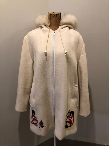 Kingspier Vintage - Canadian Sportswear pure virgin wool northern parka in cream. This parka features a hood with white fur trim, zipper closure, quilted lining, slash pockets, felt fire making design appliqués on the front and canoeing scene design on the back. Made in Canada.