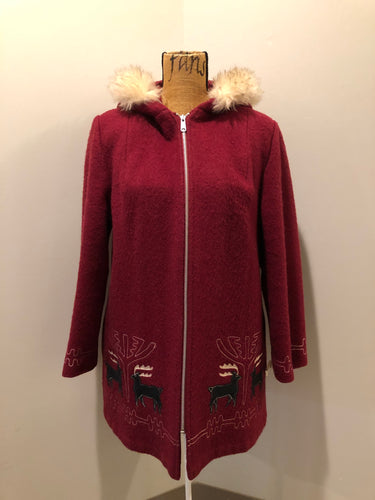 Kingspier Vintage - Sears pure virgin wool northern style parka in raspberry red. This parka features a hood with white faux fur trim, zipper closure, quilted lining, vertical pockets, hidden elastic in the lining at the wrist to keep out cold air, felt deer design appliqués on the front. Made in Canada.
