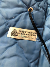 Load image into Gallery viewer, Kingspier Vintage - Northern Sun pure virgin wool northern style parka in light blue. This parka features a hood with white fur trim, zipper closure, quilted lining, slash pockets, hidden inside knit cuffs, embroidered geese design on the front and back and boats embroidered on the sleeves. Made in Canada.